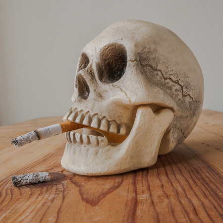 carcinogen: Close up of human skull  smoking cigarette