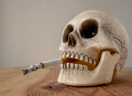 Human skull smoking cigarette
