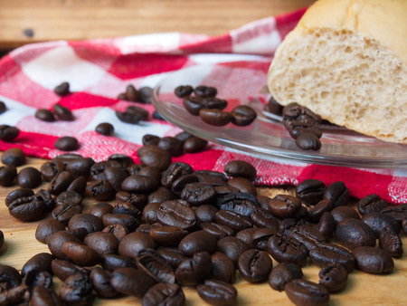 Coffee and bread on wooden background