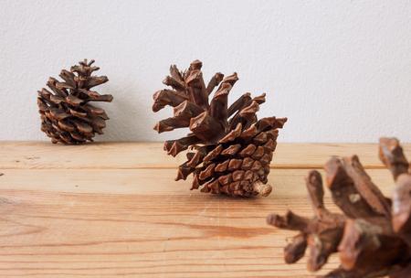 Pine cones on wood