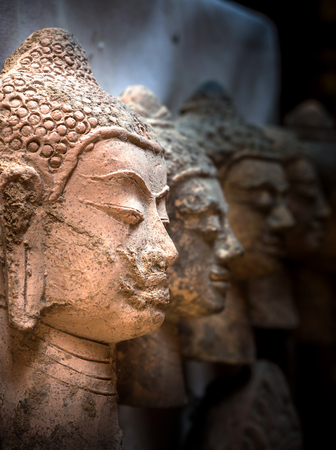 Closeup of the buddha face with light and shadow. Stock Photo