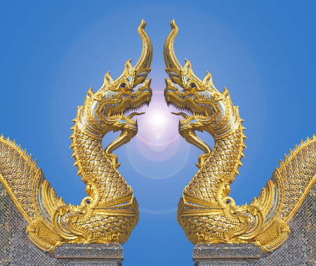 Naga facing each other with flare in blue sky at the temple is a public place.