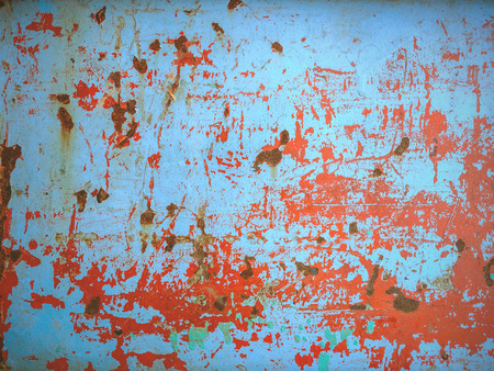 Rust on a blue and red metal sheet