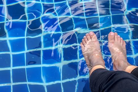 Feet soak in the pool Stockfoto