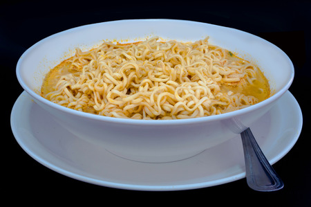 Instant noodle,Cheap food is low in nutritional value  isolated on black Reklamní fotografie