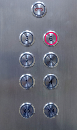 Number of floor elevator button panel select floor 6 Фото со стока