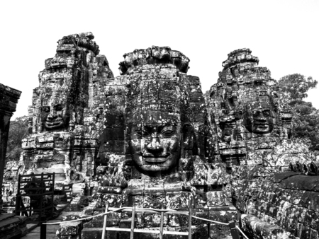 Black and white Ancient stone faces of Bayon temple, Angkor, Cambodia