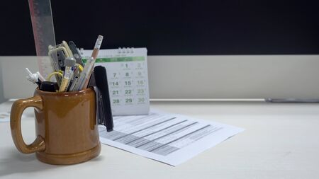 Stationery in a glass of drinking water on Desk top 스톡 콘텐츠