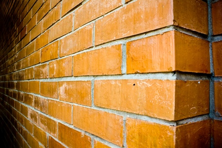Close-up details of a orange-brown brick wall.  Stock Photo