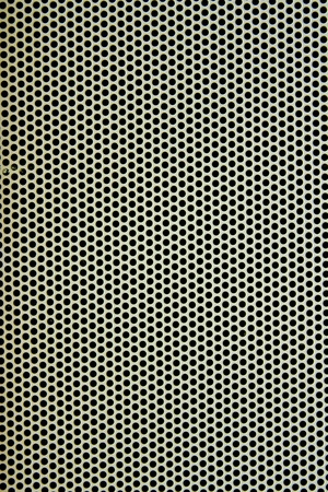 White metal plate with many small circular holes  photo