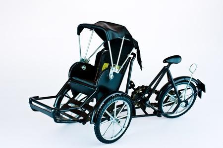 trishaw: Becak, rickshaw, pedicab isolated on white background  Stock Photo