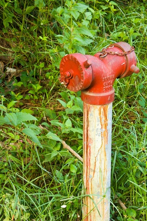 Old red fire hydrant in rural of Thailand photo