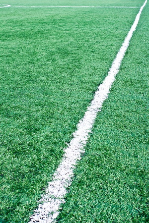 Fake grass soccer field with line photo
