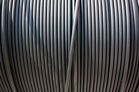 electricity cable: Close-up of black electricity cable vertical on a spool.  Stock Photo