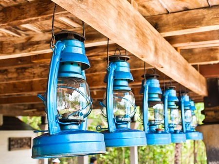 counterpoise: Perspective view of storm lanterns hanged on wooden counterpoise