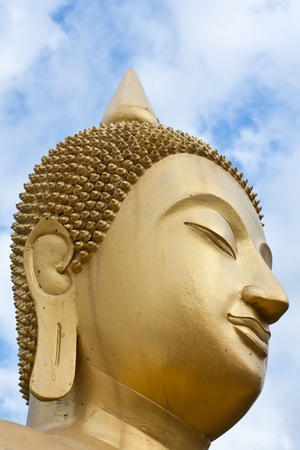 Face of gold Buddha  statue close-up photo