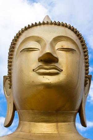 Face of gold Buddha  statue close-up photo