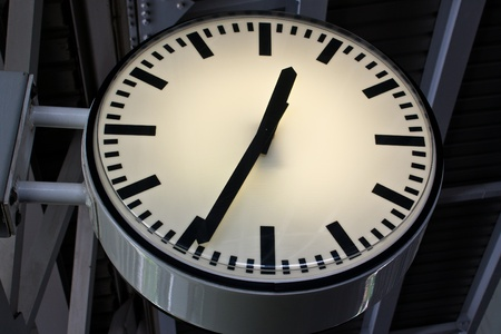 Clock at sky train station with steel construction background. photo