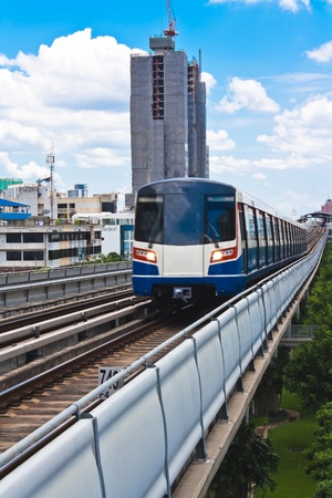 Sky train in Bangkok  with building construction.