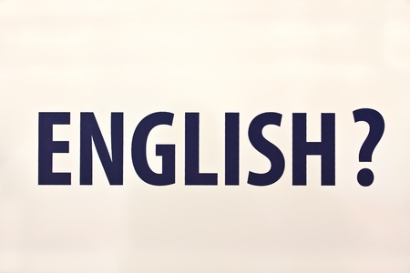 Word ENGLISH with ? on white background photo
