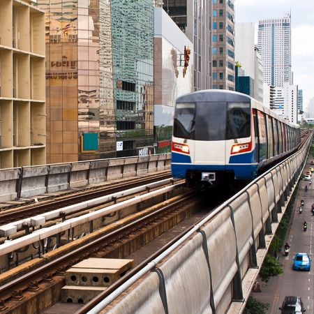 Sky train in Bangkok  with building construction. Stock Photo - 11543115