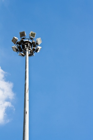 Spot-light tower in blue sky with clound photo