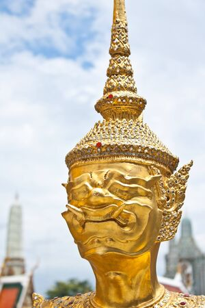 Statue the face giant at Wat Phra Kaew in Bangkok, Thailand photo