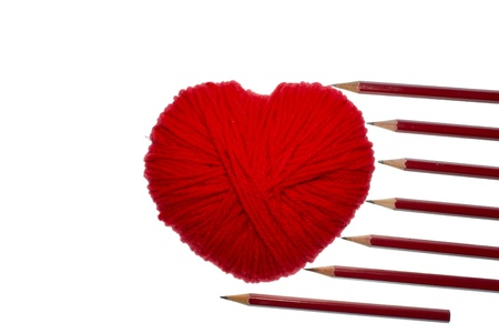 Red heart shape symbol made from wool with pencils isolated on white background Stock Photo - 12332858