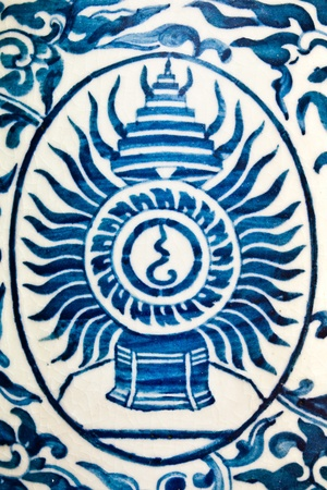 Sign of Chakri Dynasty blue and white painted on vase at Grand Palace ,Thailand