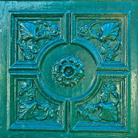 Europe style bas-relief on the green wall photo