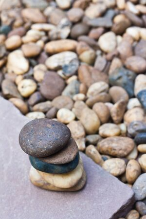 stack of zen stones on sand stone photo