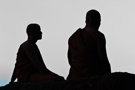 Silhouette of monk meditating at the top of the mountain Stock Photo - 15359848