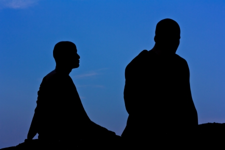 Silhouette of monk meditating at the top of the mountain Stock Photo - 15359856