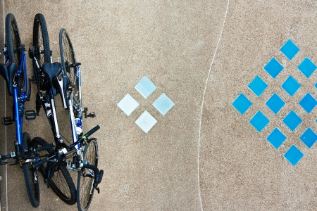 freewheel: Bird eye view of bicycles parked on the  ground Stock Photo