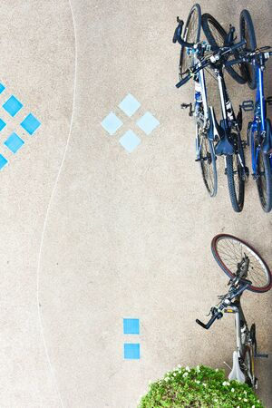 Bird eye view of bicycles parked on the  ground photo