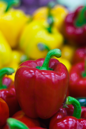 alimentary: Ripe Yellow, Red  Peppers in Vegetables Market