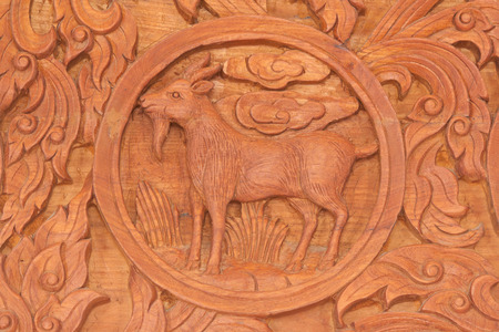 Wood carving of goat Chinese zodiac animal sign Stock Photo