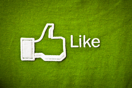thumb keys: Amphawa, Thailand - Dec 29, 2012: Facebook like icon on fabric, Facebook is largest social networking website in the world.