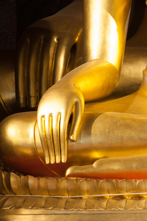 Close up of golden Buddhist statue hand Stock Photo