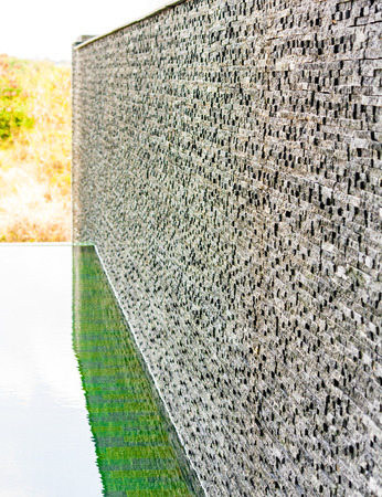 Dark grey stone tile  dbrick wall backgrounf Stock Photo