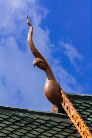 Thai style gable apex in blue sky Stock Photo