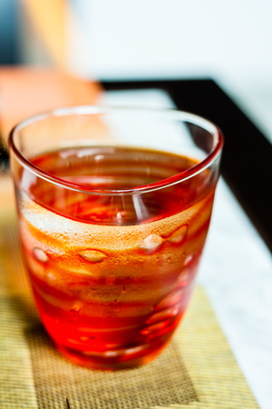 Glass of cold water on napery Stock Photo