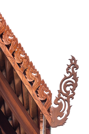 Wooden toothlike ridges on the sloping edges of a gable