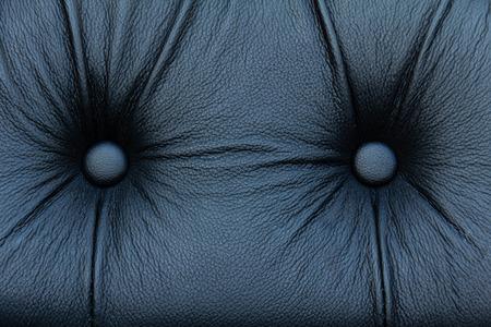 Black genuine leather sofa pattern as background image