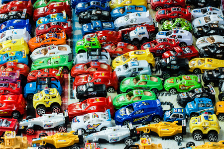 Many small toy cars lined up on future board