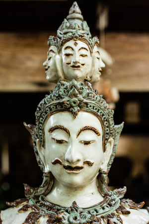 Face of Thai male angel traditional style ceramc sculpture Stock Photo