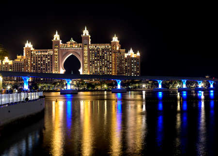 Dubai - UAE. 13th november 2020. View of The Atlantis Hotel with colorful reflection on water from The Pointe Palm Jumeirah.