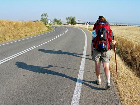 camino: couple and their shadows walking the Camino de Santiago