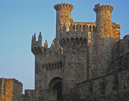 europeans: setting sun cast sunlight onto medieval stone castle