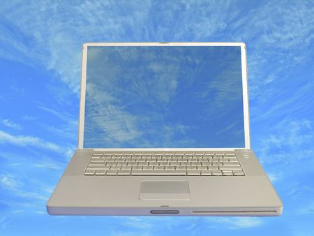 portable rom: front view of laptop computer with clear screen to blue cloudy background Stock Photo